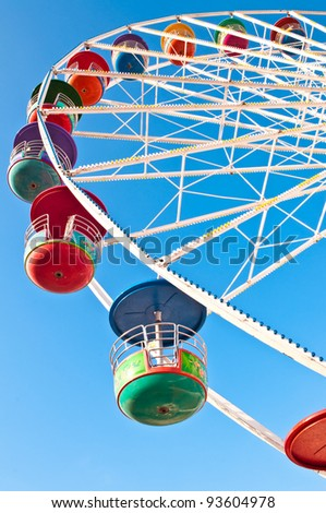 Colorful ferris wheel and blue sky. - stock photo