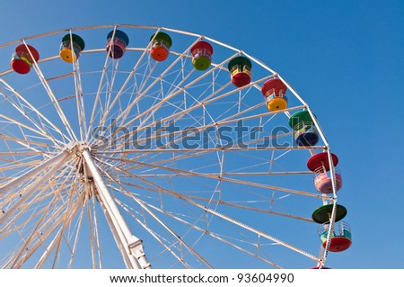 Colorful ferris wheel and blue sky.