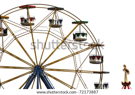 Colorful ferris wheel and carousel horse in amusement park. - stock photo