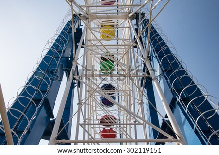 Colorful Ferris wheel on the background of sky - stock photo