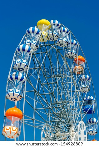 Colorful ferris wheel with blue sky.