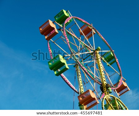 Colorful ferris wheel with blue sky background and copy space - stock photo