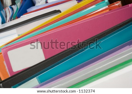 Colorful files with space for your text on pink folder. - stock photo