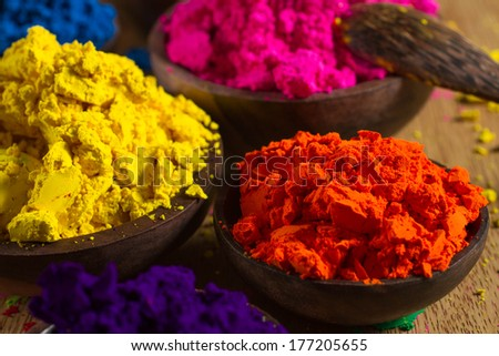 Colorful, finely powdered Indian pigments. Focus on orange. - stock photo