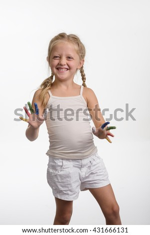 Colorful fingers of a little child. Young girl painted her hands with different colors of paint. Pleased with being naughty. - stock photo