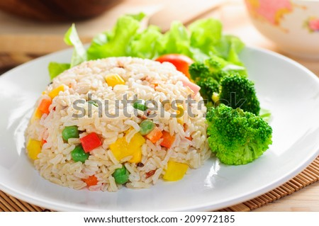 colorful fired rice on white plate - stock photo