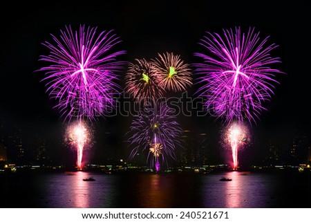 Colorful firework display on celebration night, Happy new year - stock photo