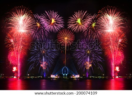 Colorful firework display on the river, city night