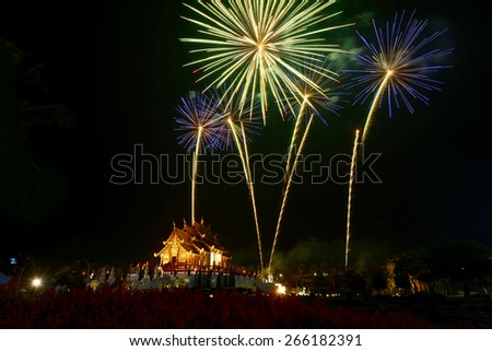 Colorful firework in a night sky at Ho kham luang at Royal Park Rajapruek in chiang mai,Thailand