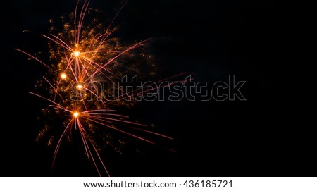 Colorful fireworks abstract pattern with glowing lines. Red orange flash on black scene background. copy space - stock photo