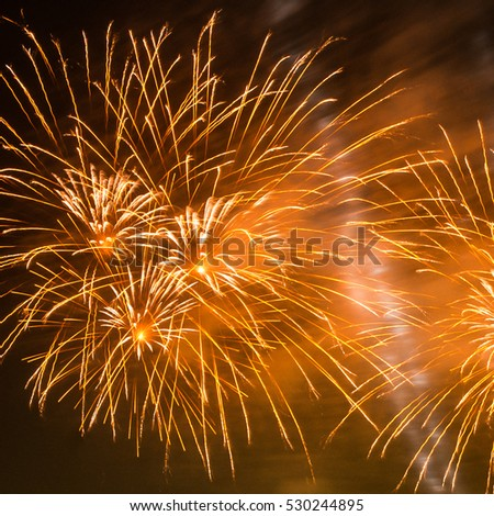 Colorful fireworks and smoke on the black sky background. Holiday celebration.