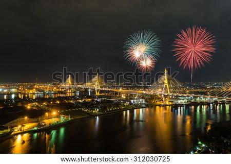 Colorful fireworks at Bhumibol bridge beetween King Bhumibol 's birthday (Father'sday) , Bangkok , Thailand - stock photo