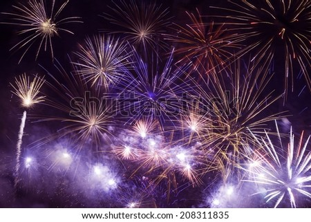 Colorful Fireworks Background. Fireworks on Black Sky. - stock photo