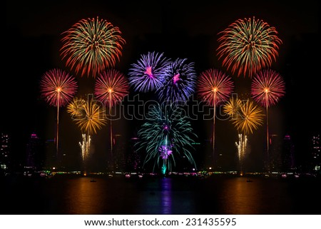 Colorful fireworks display in celebration night  - stock photo