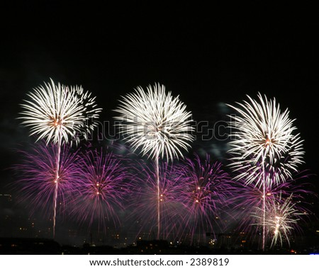 Colorful fireworks display. Shot with  tripod and shutter release cable. - stock photo