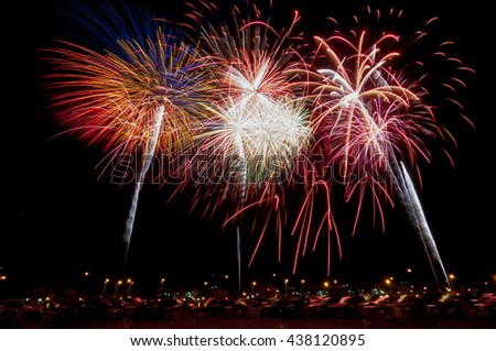 Colorful fireworks explode from the edges of the frame in a fireworks show celebrating July 4th Independence Day.  - stock photo
