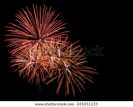 Colorful fireworks exploding in the night sky with copy space - stock photo