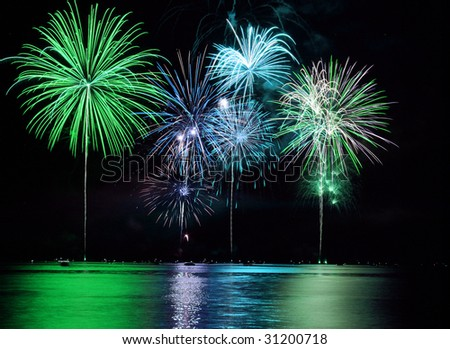 Colorful Fireworks for the Grand Finale over Lake - stock photo