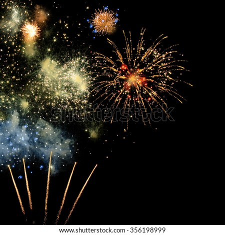 Colorful fireworks in the black night sky; New Year's Eve; Party time - stock photo