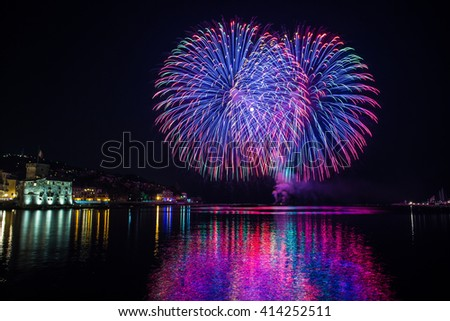 Colorful fireworks of various colors over night sky / special night with special fireworks / Beautiful fireworks in dark night - stock photo