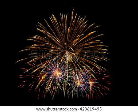 Colorful fireworks of various colors over night sky  - Vibrant color effect - stock photo