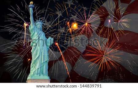 Colorful fireworks on black sky with statue of liberty and flag - stock photo