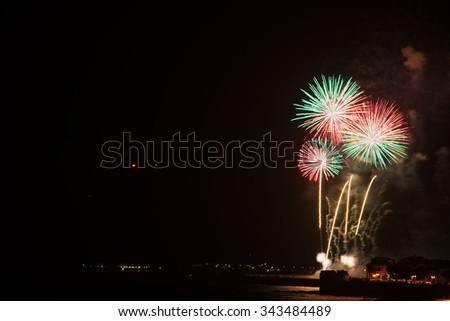 colorful fireworks over Alghero shoreline, Italy - stock photo