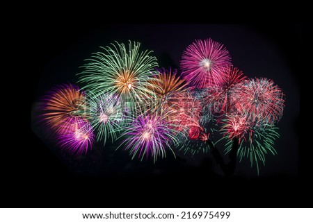Colorful fireworks over dark sky  - stock photo