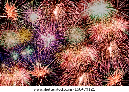 colorful fireworks over dark sky abstract for background - stock photo