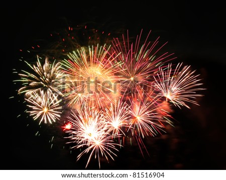 Colorful fireworks over dark sky, displayed during a celebration in Barcelona - stock photo