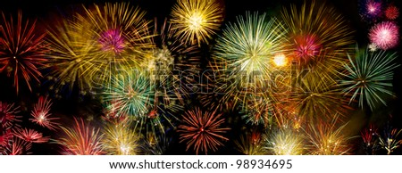Colorful fireworks over dark sky during a celebration - stock photo