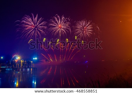 Colorful fireworks reflected in the lake