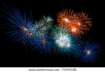 Colorful fireworks streaks in the night sky during international fireworks festival - stock photo