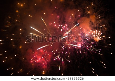 Colorful fireworks with copy space at the bottom and at the top- insert your own text - stock photo