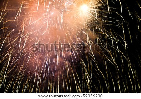 Colorful fireworks with copy space lower and right borders - insert your own text - stock photo