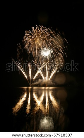Colorful fireworks with water reflection - stock photo