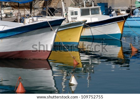 Colorful fishermen boats mooring in old Jaffa port in Tel Aviv Jaffa port, Israel. - stock photo