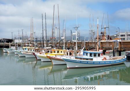 Colorful fishing boats in Fisherman Wharf, San Francisco CA. - stock photo