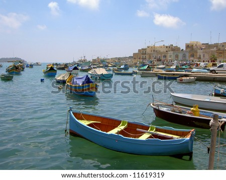 Colorful fishing boats in Marsaxlokk harbor, Malta