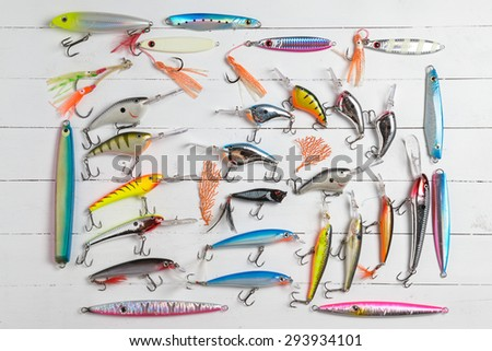Colorful Fishing Lures on wood desk different fishing baits - stock photo