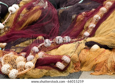 Colorful fishing nets in the port of Saint-Jean-de-Luz in Basque country in France - stock photo