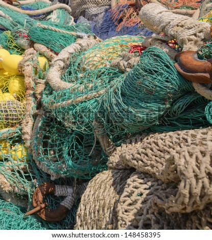 Colorful fishing nets with knots and nets closeup. - stock photo