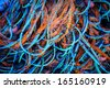 colorful fishing network in a pile closeup - stock photo