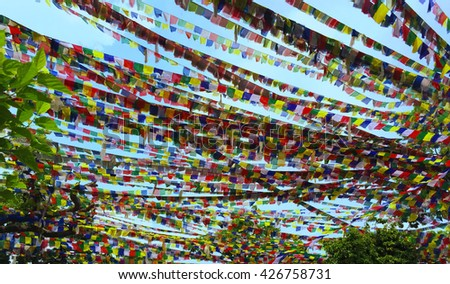 Colorful flags background, buddhist praying flags, buddhist prayers flags, colorful flag ribbons, Kathmandu colorful flag, buddhist fla in Nepal, summer day and colorful flags, blue sky view and flags - stock photo