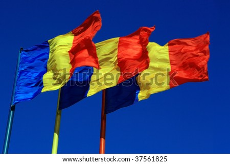 colorful flags blowing in a strong wind - stock photo