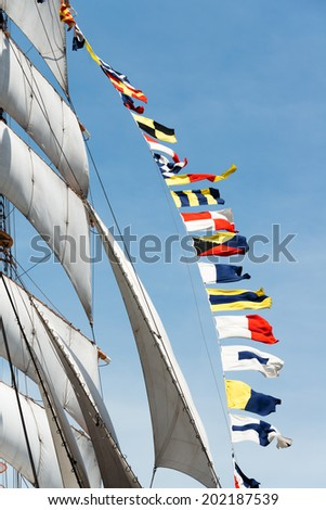 Colorful flags on a sailboat - stock photo
