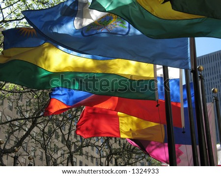 Colorful flags wave in the breeze - stock photo