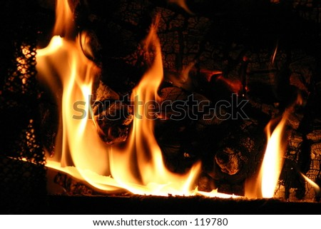 Colorful flames engulfing wood.