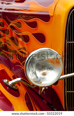 colorful flaming paintwork and headlamp on a custom hotrod - landscape version also available - stock photo