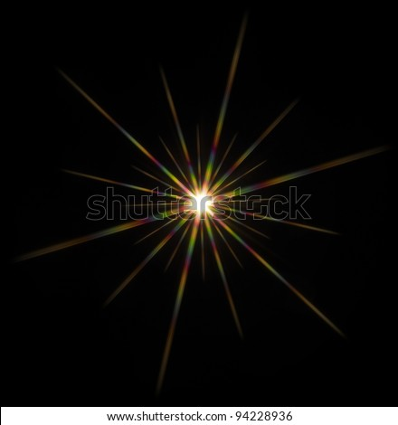 colorful flashy spotlight star made with optical star filter on camera - stock photo